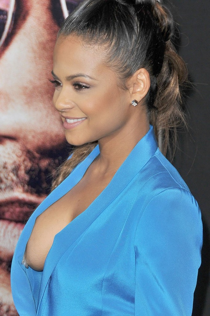 """Christina Milian's side boob makes an appearance at the """"Focus"""" premiere in Hollywood"""