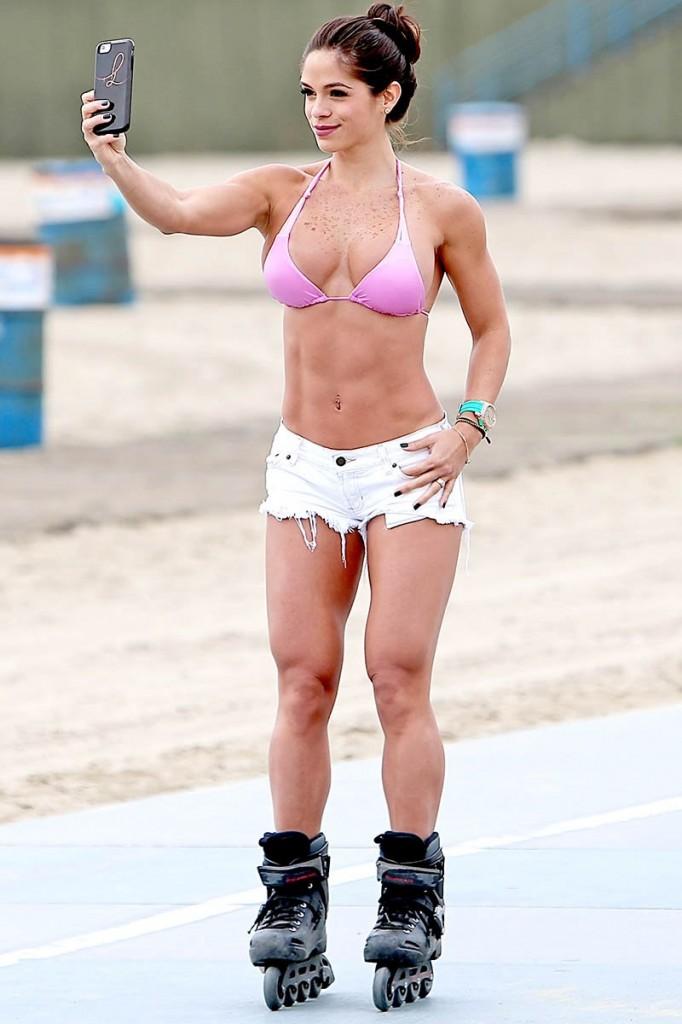 Michelle Lewin rocks short shorts as she roller blades on Venice Beach
