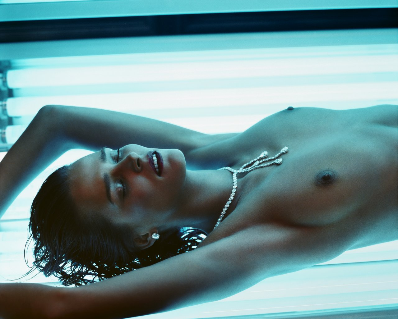 Nude tanning bed photo well