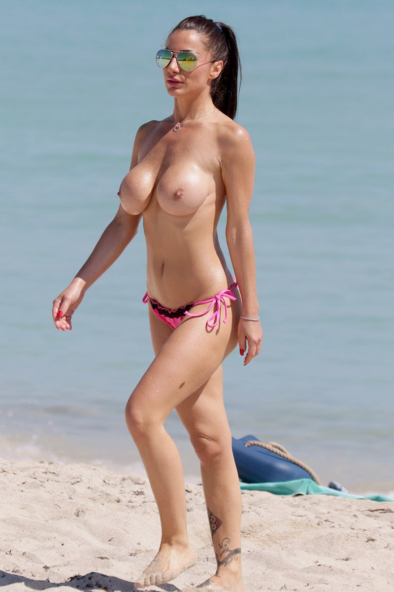 LOOKS SOO huge hot boobs topless on the beach her and