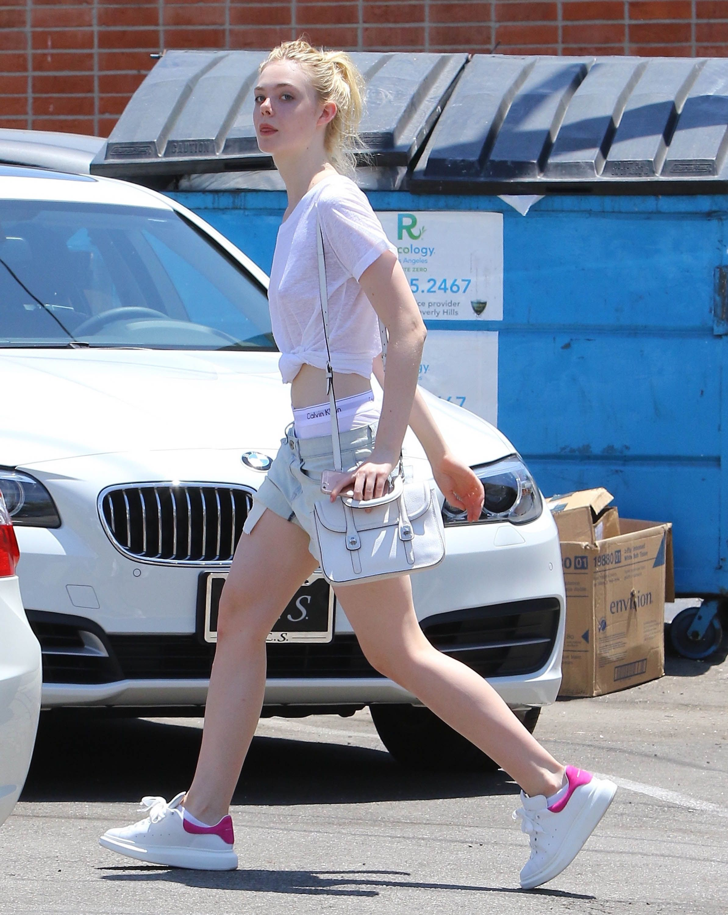 paparazzi photos of elle fanning braless and showing undies out in