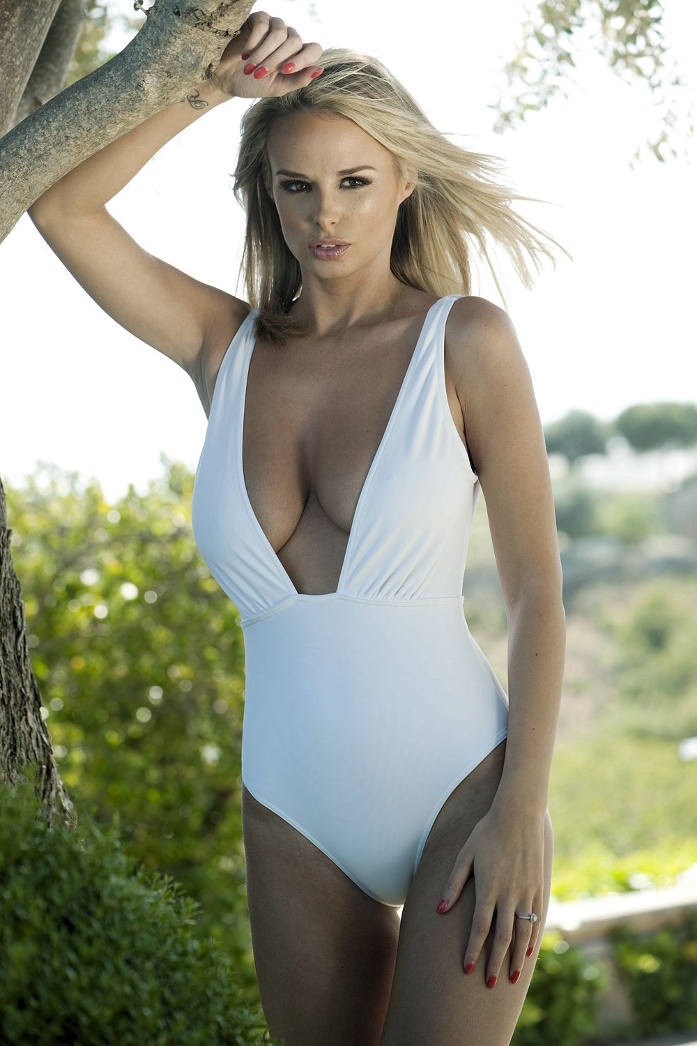 Rhian Sugden in a Swimsuit & Topless (3 Photos)