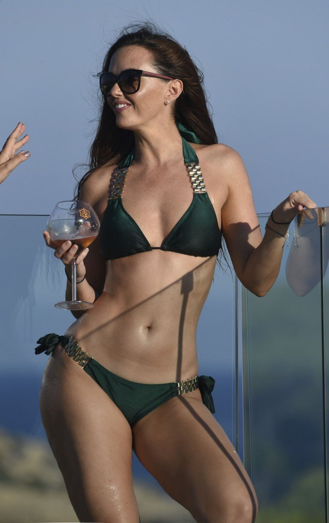 Jennifer Metcalfe shows off her stunning body as she chills by the pool at the ME Hotel in Ibiza. (STRICTLY NO ONLINE USE)