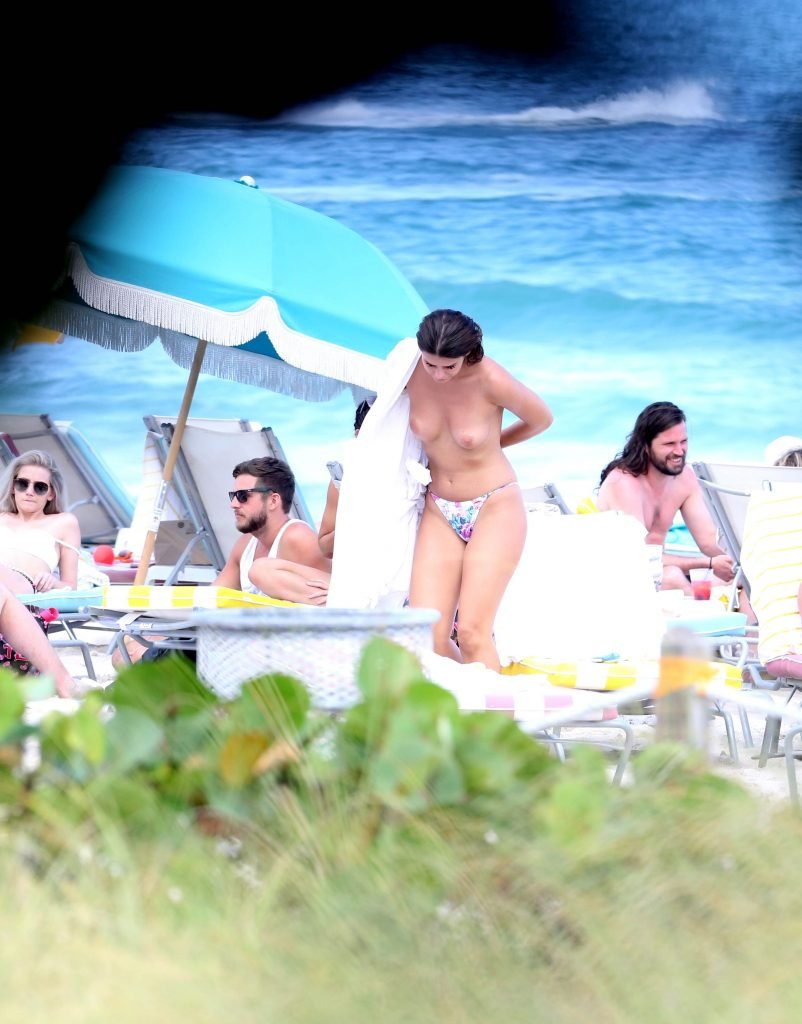 Nima Benati Topless (8 Photos)