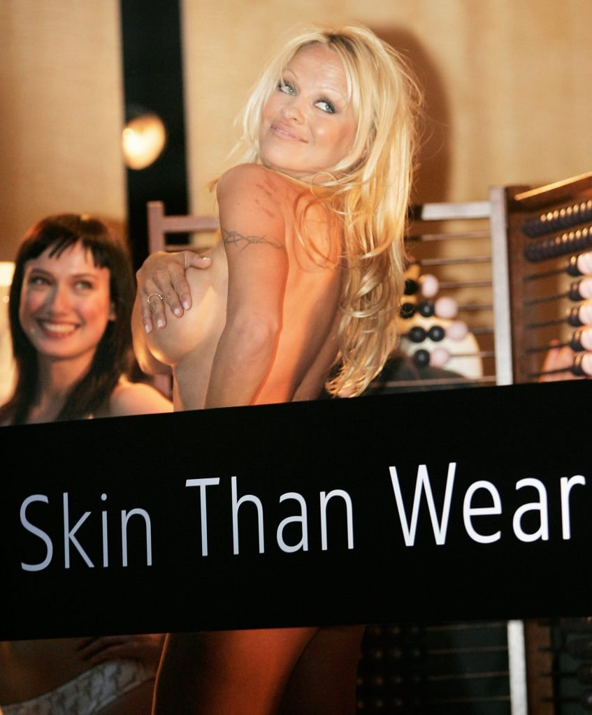 Pamela Anderson Topless (11 Photos + Video)