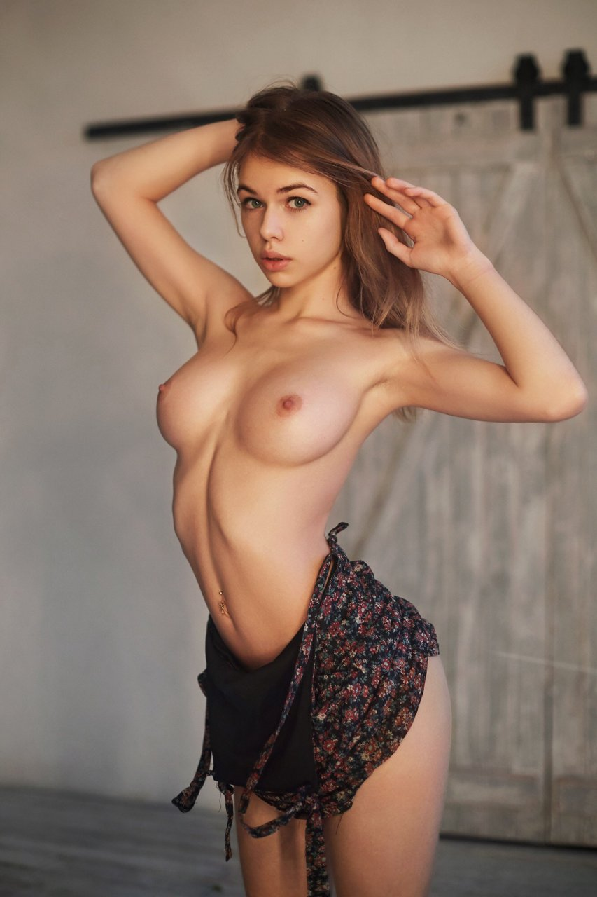 Russian girl poses nude in the streets 10