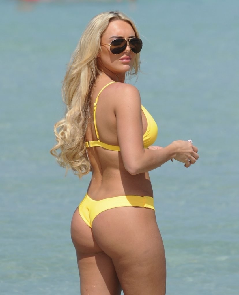 Amber Turner Shows Off Her Assets On The Beach (27 Photos)