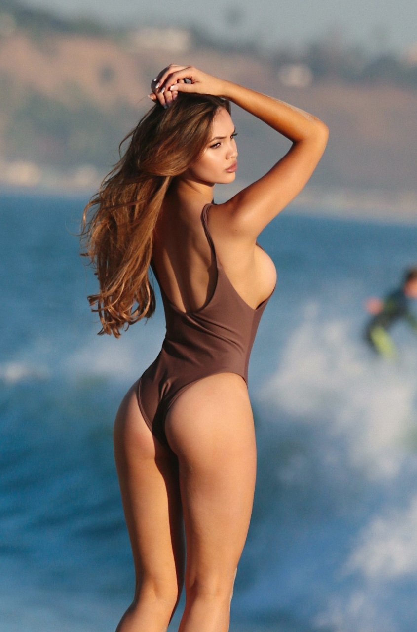 Sammy mitchell posing in a swimsuit nipslip
