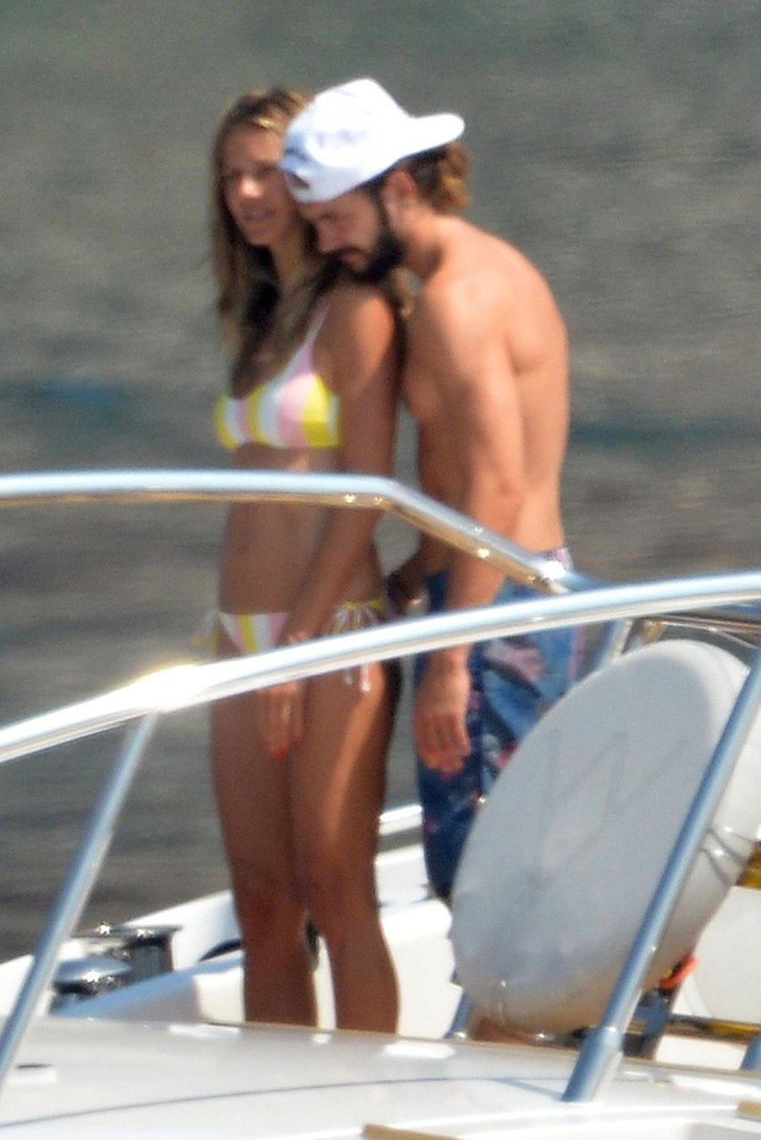 Heidi Klum topless on vacation with 28-year-old rocker on a yacht in Italian island of Ponza, 08/07/2018.