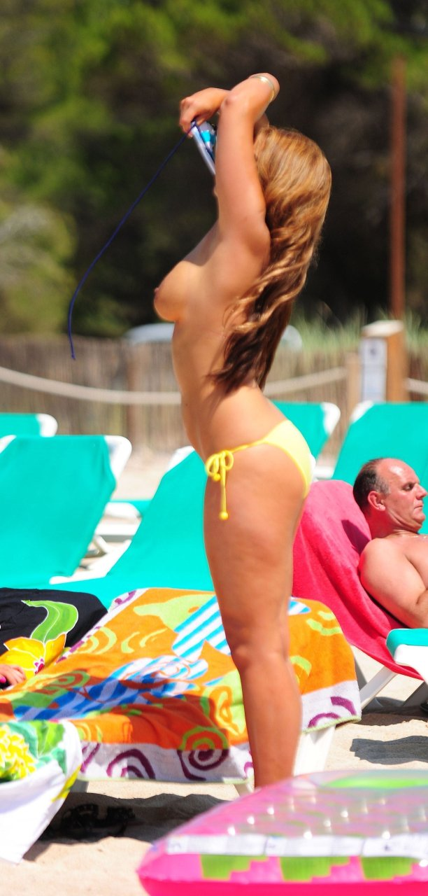 Rachael White was seen oily topless on the beach in Ibiza 06/29/2011.