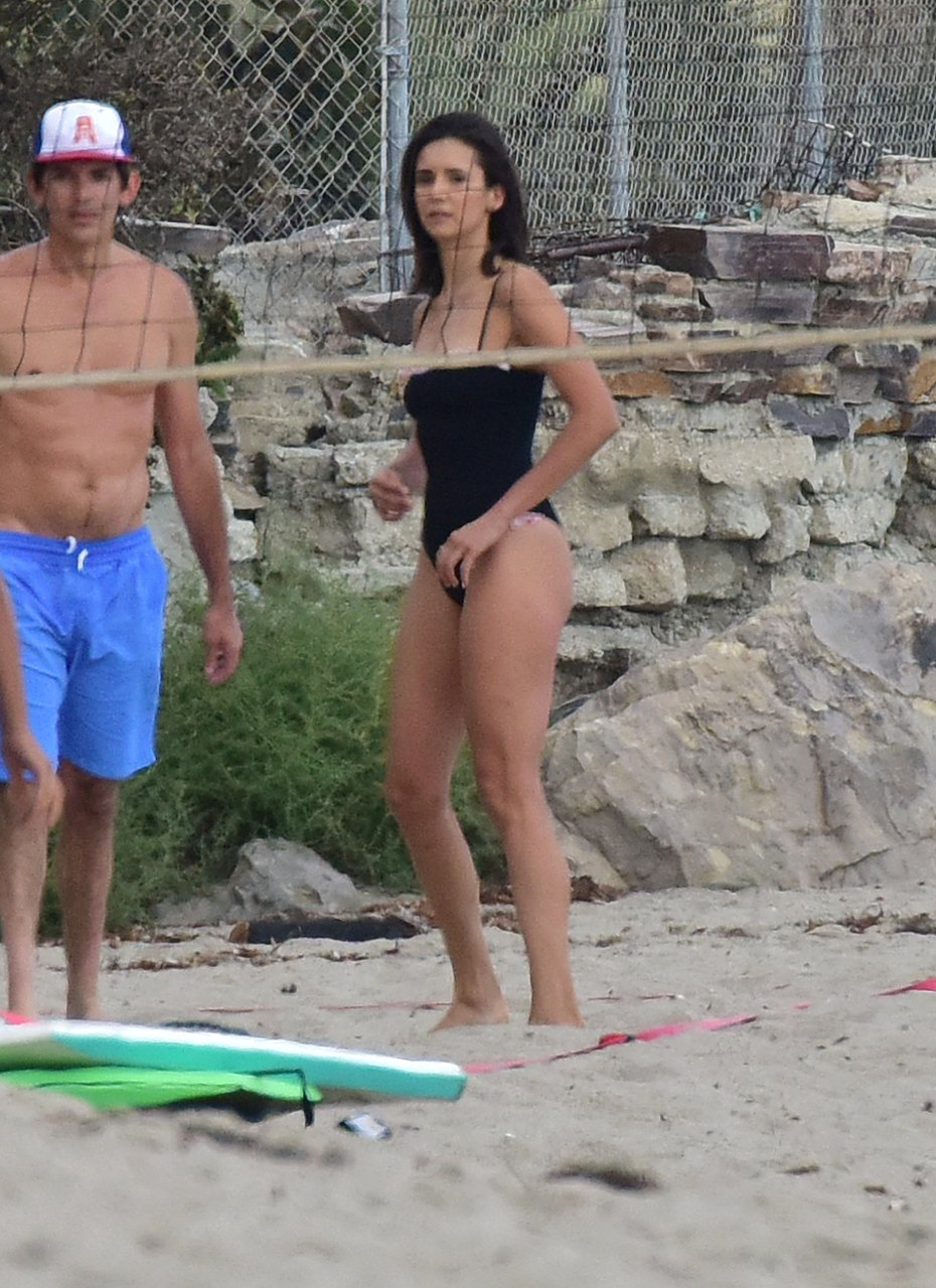 Nina Dobrev was seen in a black swimsuit while playing volleyball with friends on the beach in Malibu, 09/02/2018