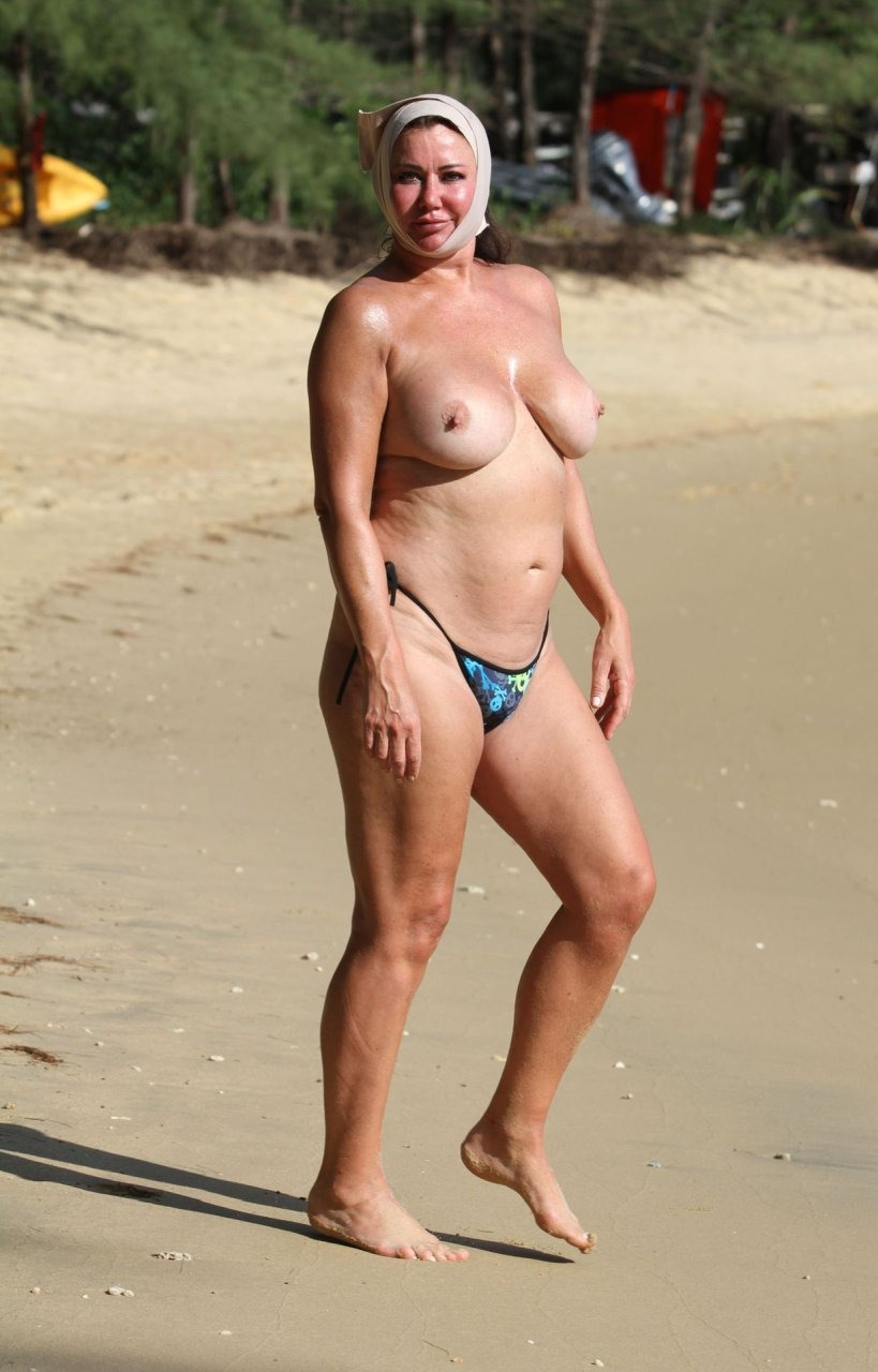 Lisa Appleton TOPLESS on the beach of her luxury Impiana Hotel Resort in Patong, 03/12/2018.
