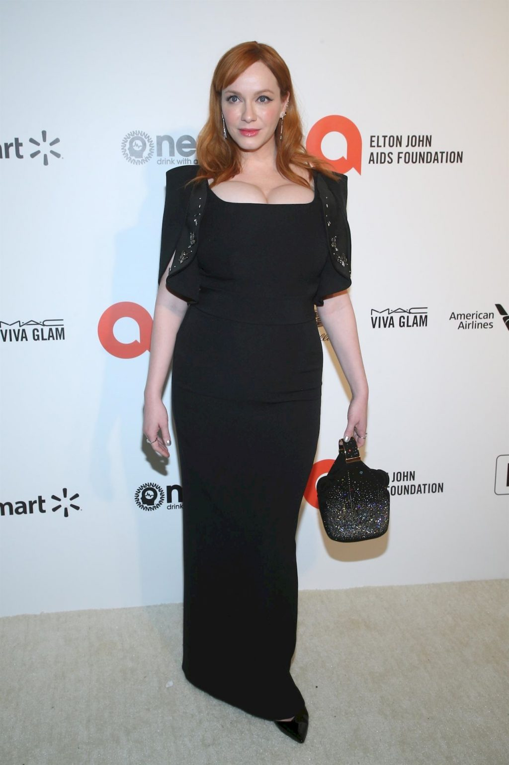 Christina Hendricks Shows Off Her Big Boobs at the 28th Annual Elton John Oscar Viewing Party (14 Photos)
