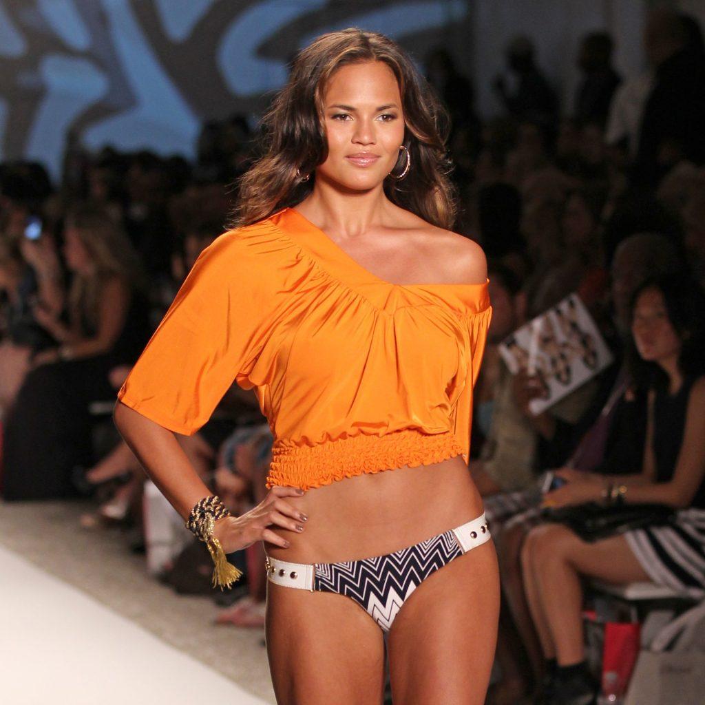 Chrissy Teigen Walks the Runway at Beach Bunny Swimwear during Miami Swim Week (26 Photos)