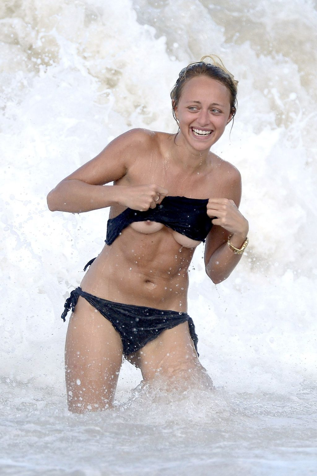 Lana Scolaro Shows Her Nude Tits on the Beach (12 Photos)