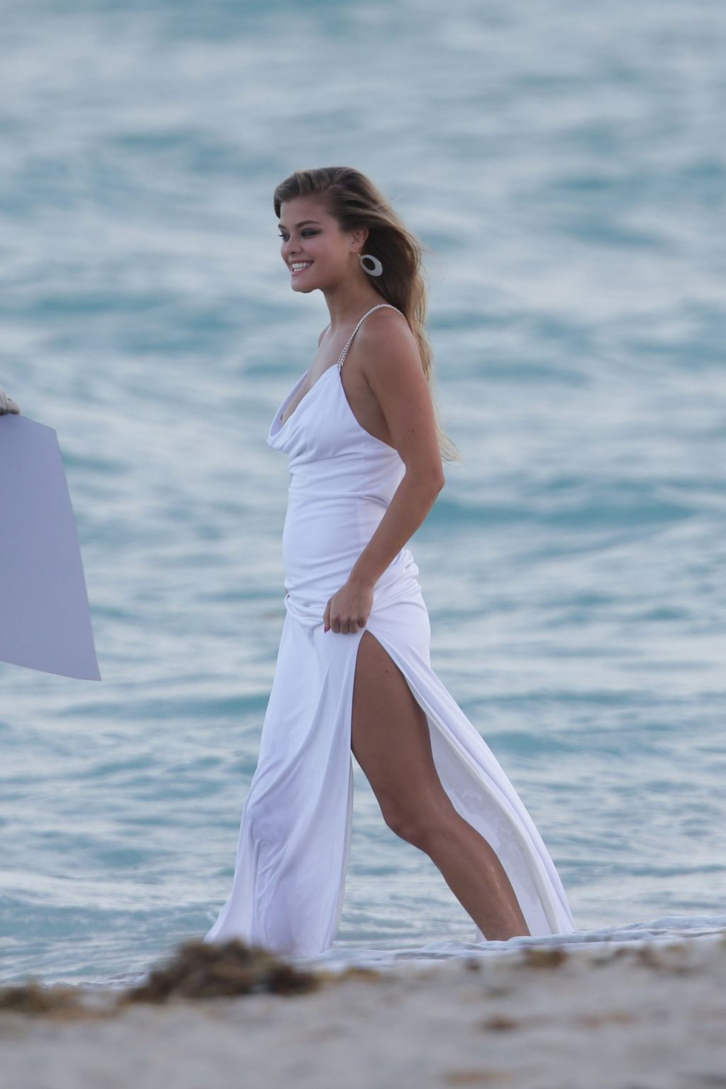 Nina Agdal Has a Couple Wardrobe Malfunctions While Navigating The Surf For a Photoshoot (25 Photos)