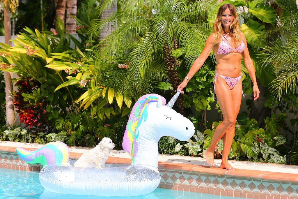 Kelly Bensimon Plays with Her Dog in the Pool in West Palm Beach (39 Photos)