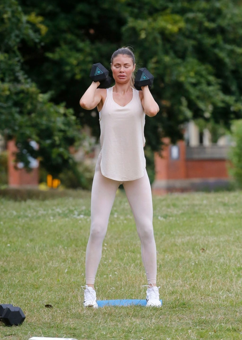 Busty Chloe Sims Works Out with Her Personal Trainer in a Park (31 Photos)