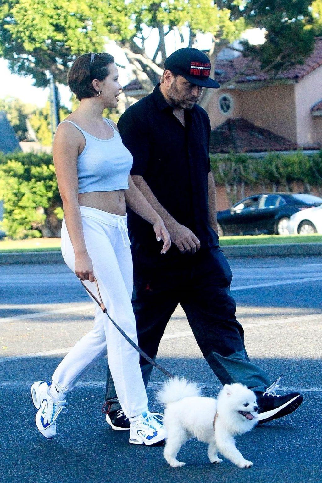 Braless Mara Teigen Enjoys a Stroll with a Man (14 Photos)