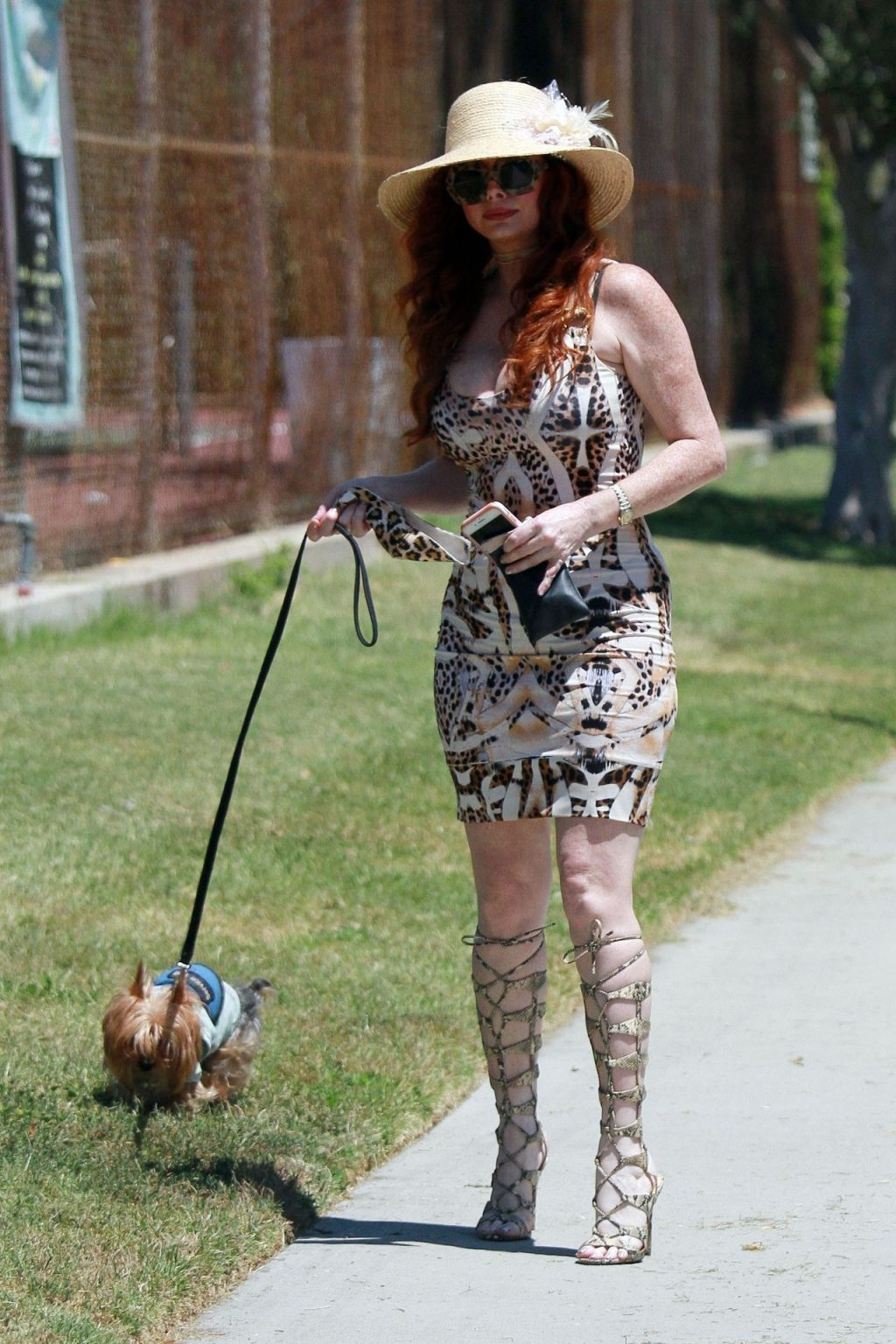 Phoebe Price Takes Her Pooch for a Walk in a Park (36 Photos)