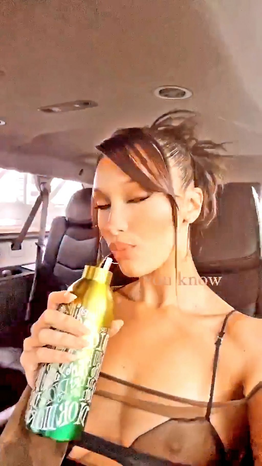 Bella Hadid Shows Off Her Tits in a Car (5 Pics + GIF & Video)