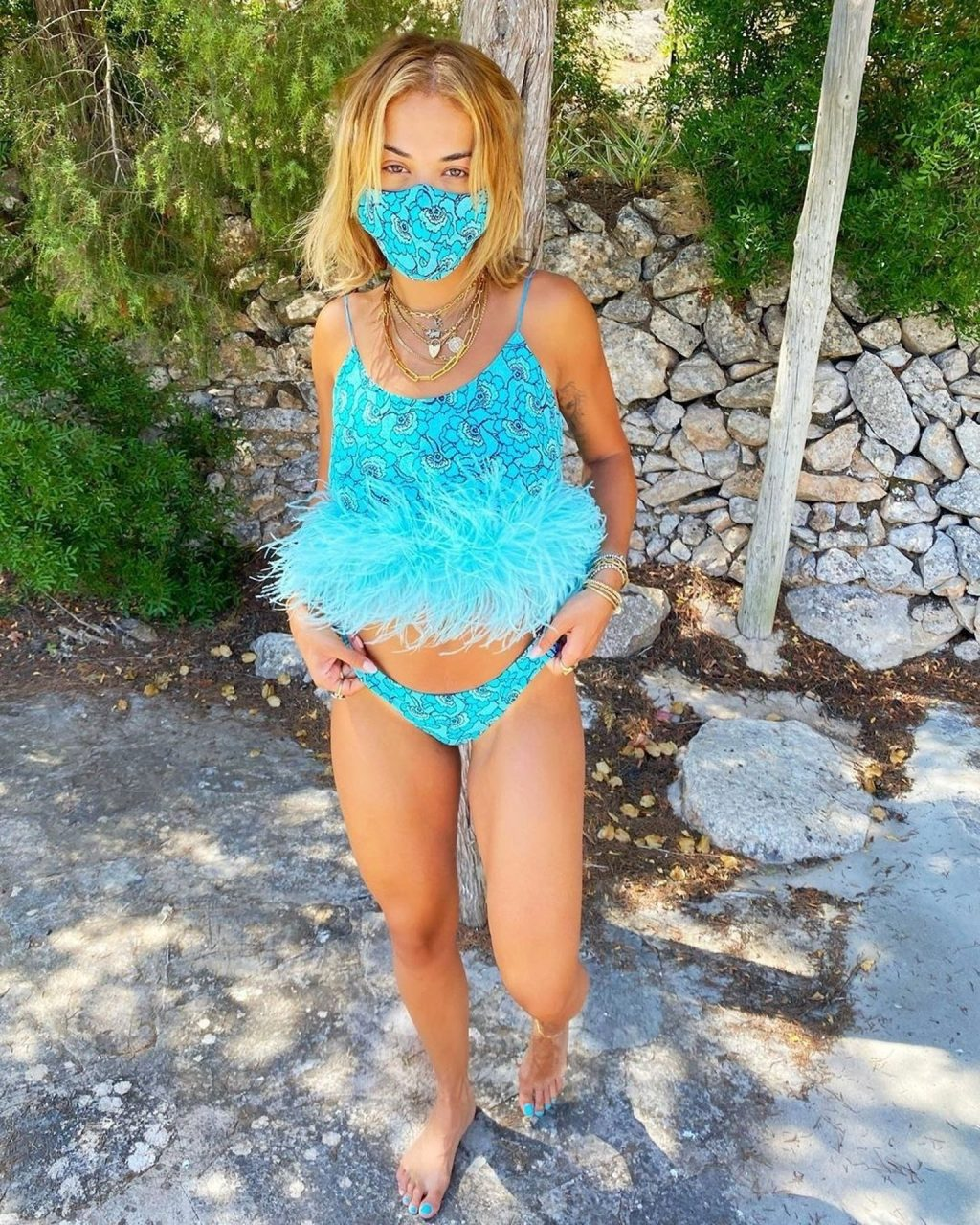 Sexy Rita Ora Poses in a Turquoise Bikini (5 Photos)