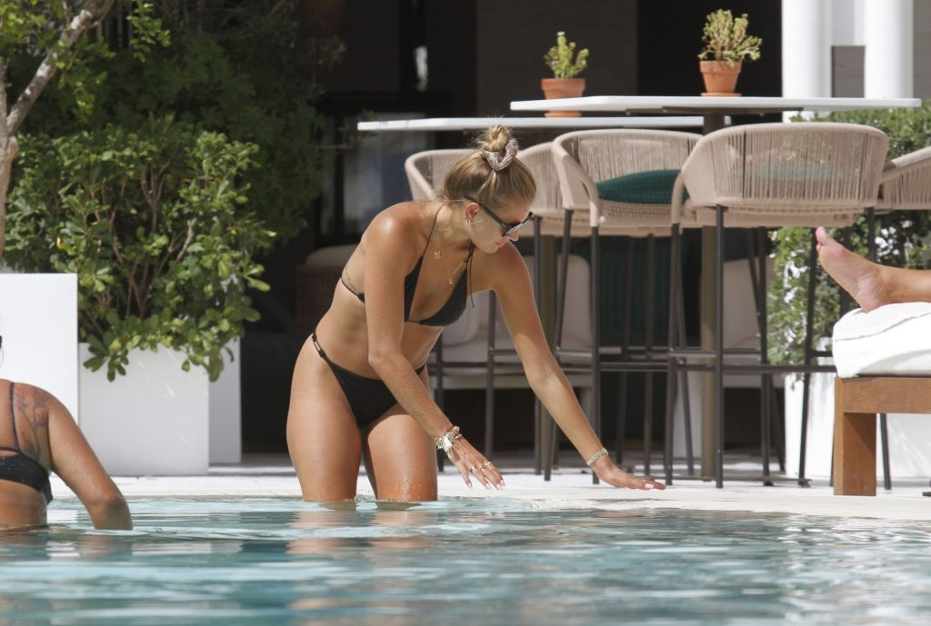 Arabella Chi Relaxes by the Pool in Marbella (27 Photos)