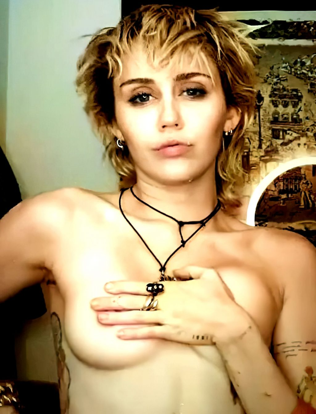 Miley Cyrus Poses Topless (10 Pics + Video)