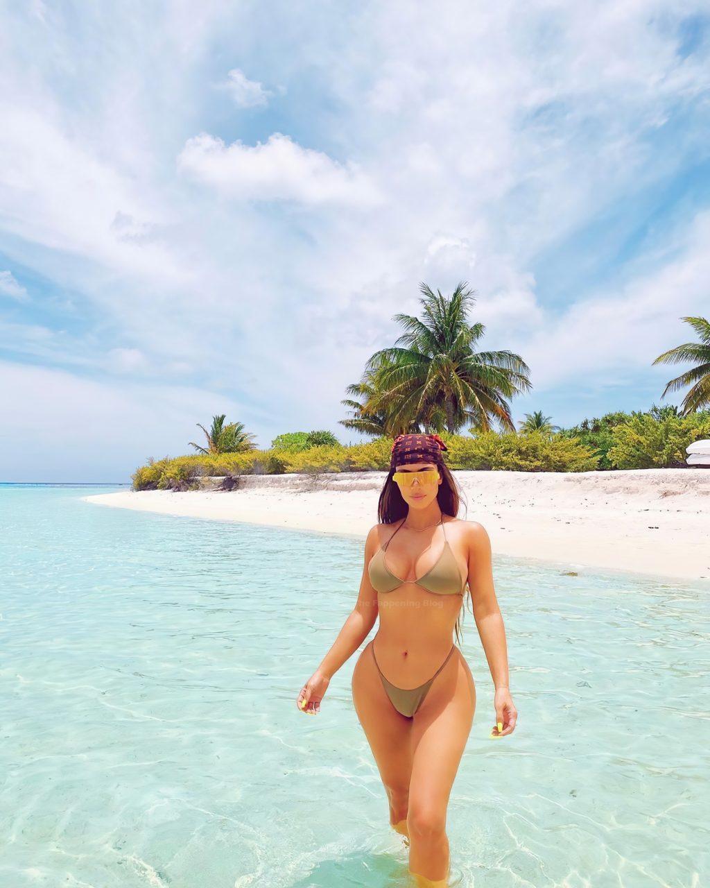 Kim Kardashian Models in a Bikini (5 Photos)