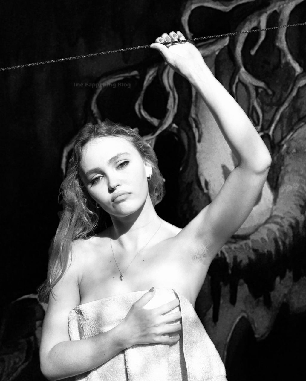 Lily-Rose Depp Poses Topless (4 Photos)