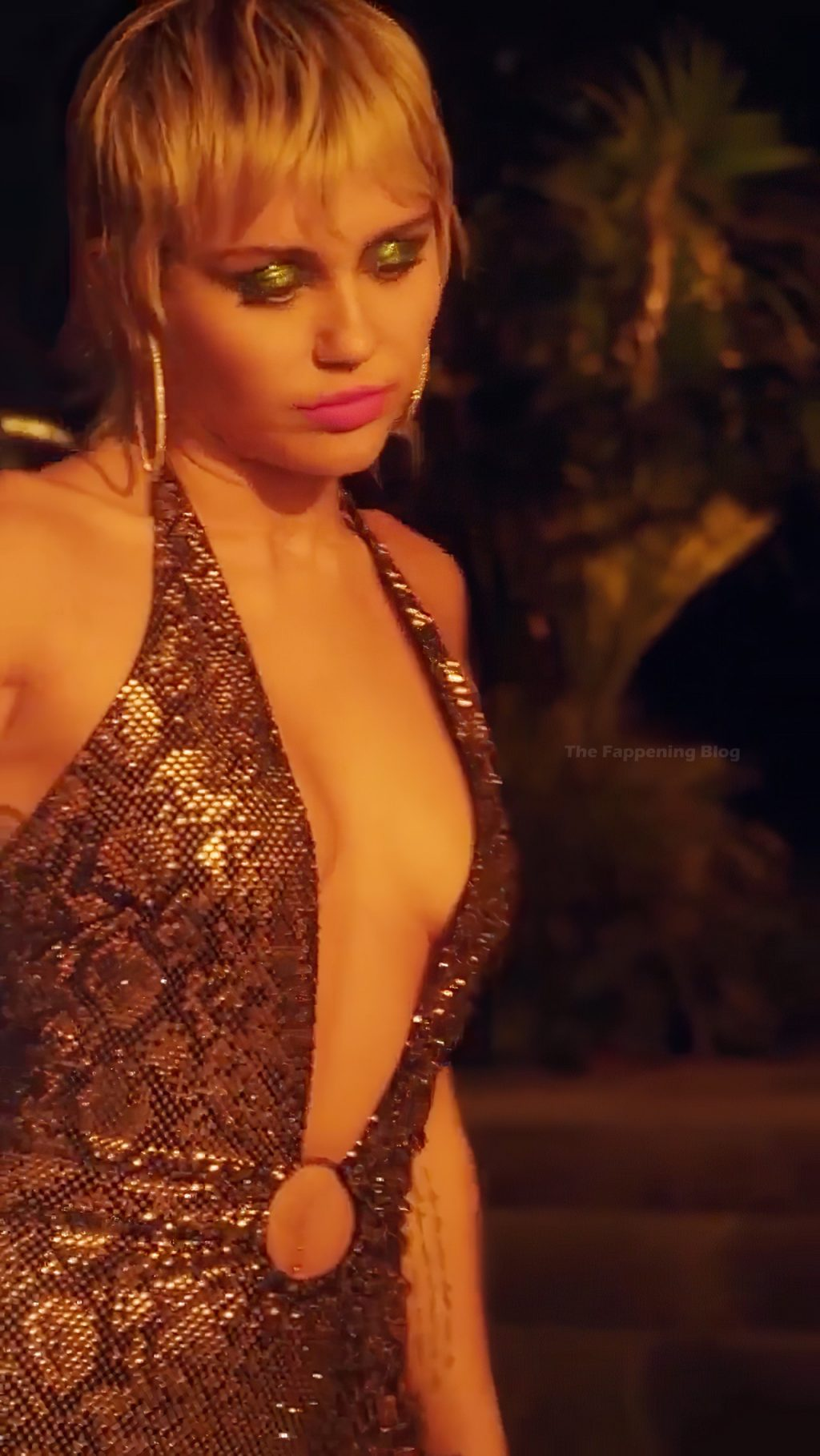 Miley Cyrus Shows Off Her Cleavage on Stage (4 Pics + Video)
