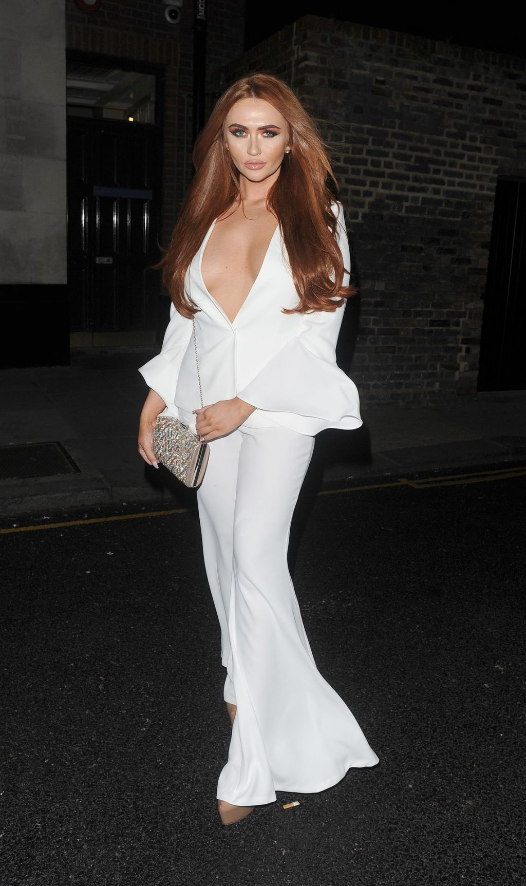 Charlotte Dawson Shows Off Her Tits in London (6 Photos)