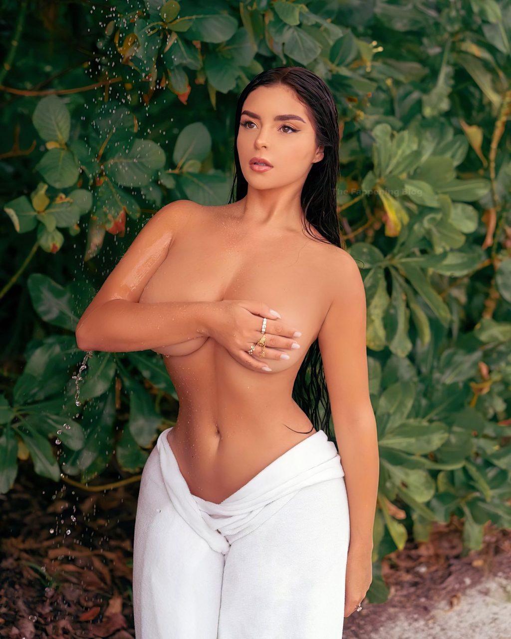 Demi Rose Poses Topless (2 Photos)