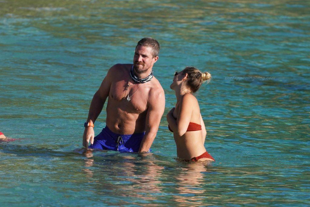 Stephen & Cassandra Amell Enjoy a Day on the Beach in St. Barts (14 Photos)