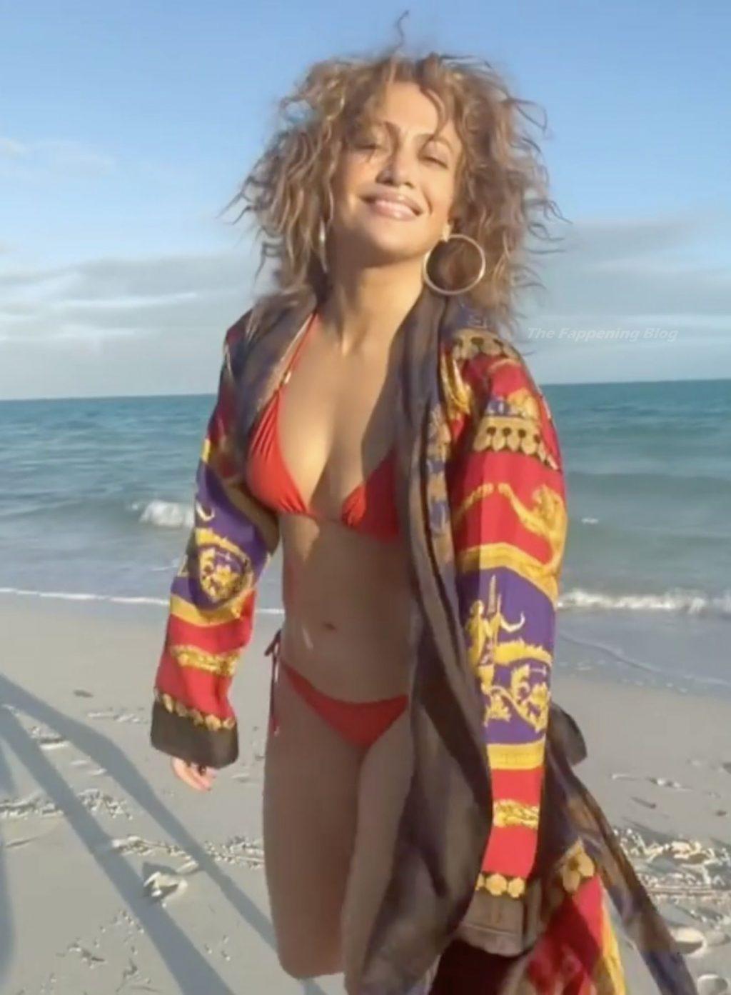 Jennifer Lopez Hits the Beach in a Red Bikini (12 Pics + Video)