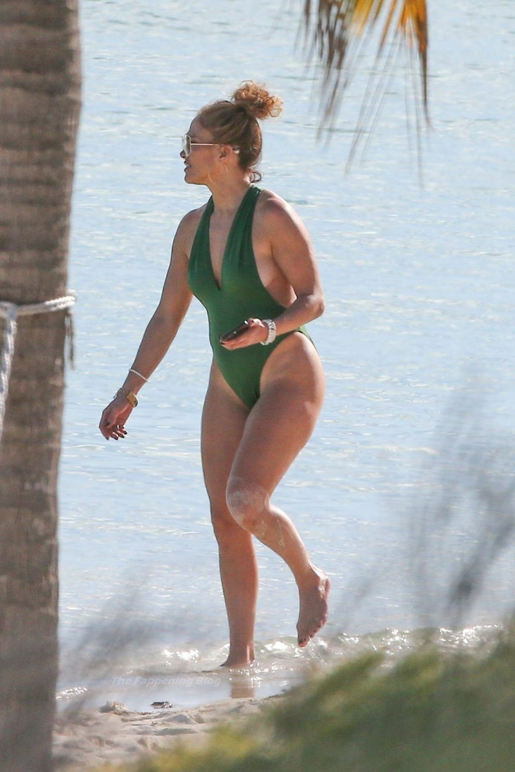 Jennifer Lopez is Pictured in a Green Swimsuit as She Soaks in the Sun in Turks and Caicos (14 Photos)