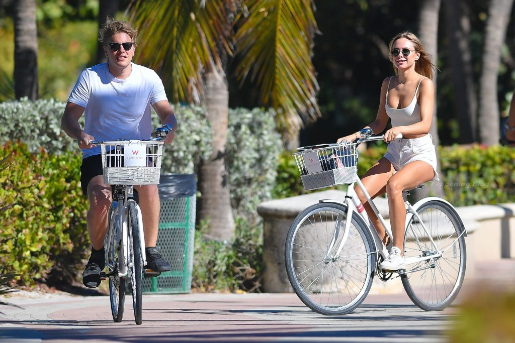 Kimberley Garner Wears Bright Whites For Sunny Bike Ride in Miami Beach (27 Photos)