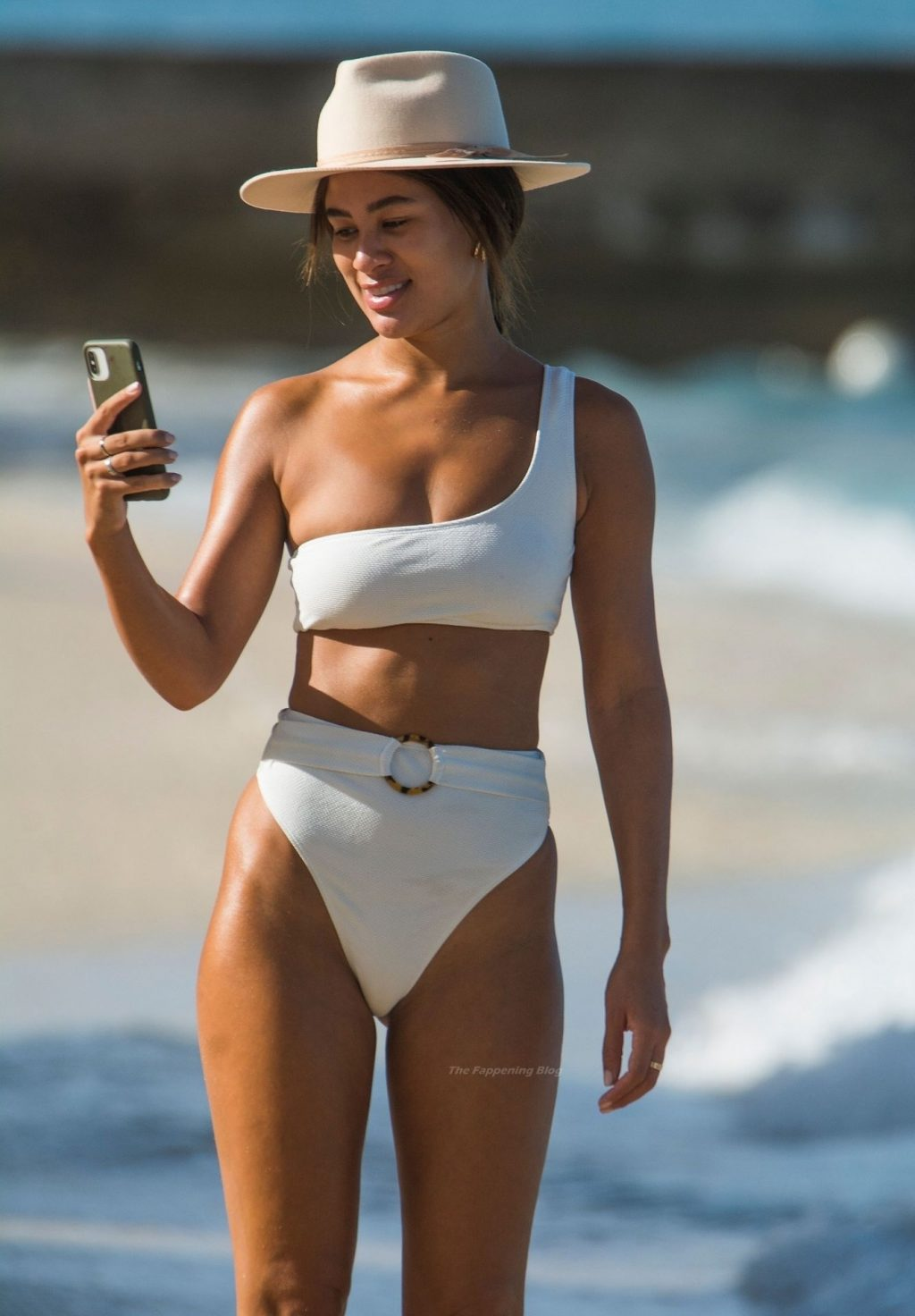Montana Brown Showcases Her Sexy Curvaceous Beach