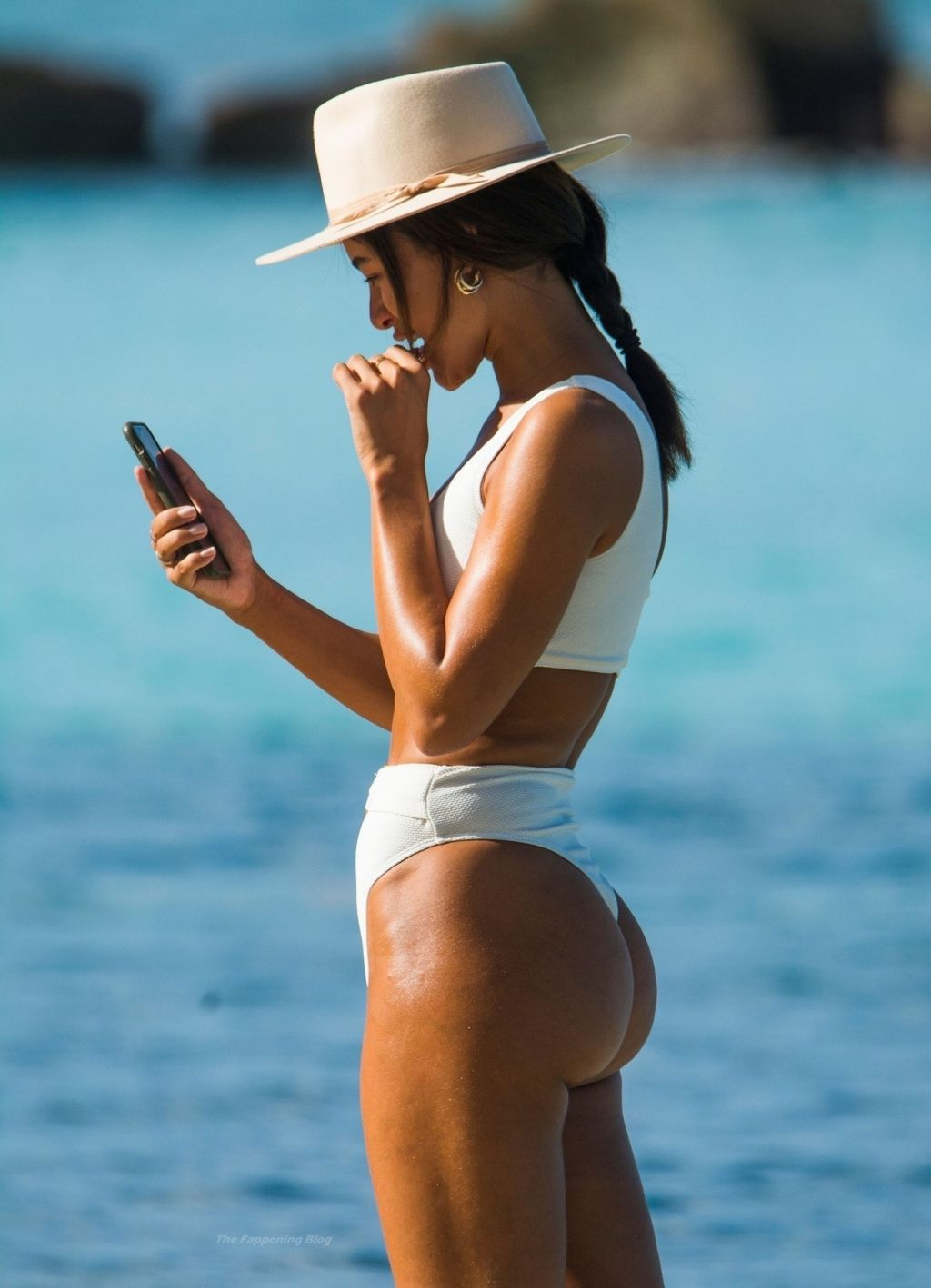Montana Brown Showcases Her Sexy Curvaceous Beach Body Physique in a White Swimsuit (56 Photos)