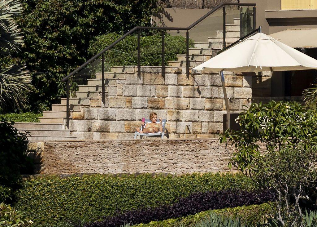 Rita Ora Sunbathes on the Deck of Her Sydney Mansion (28 Photos)