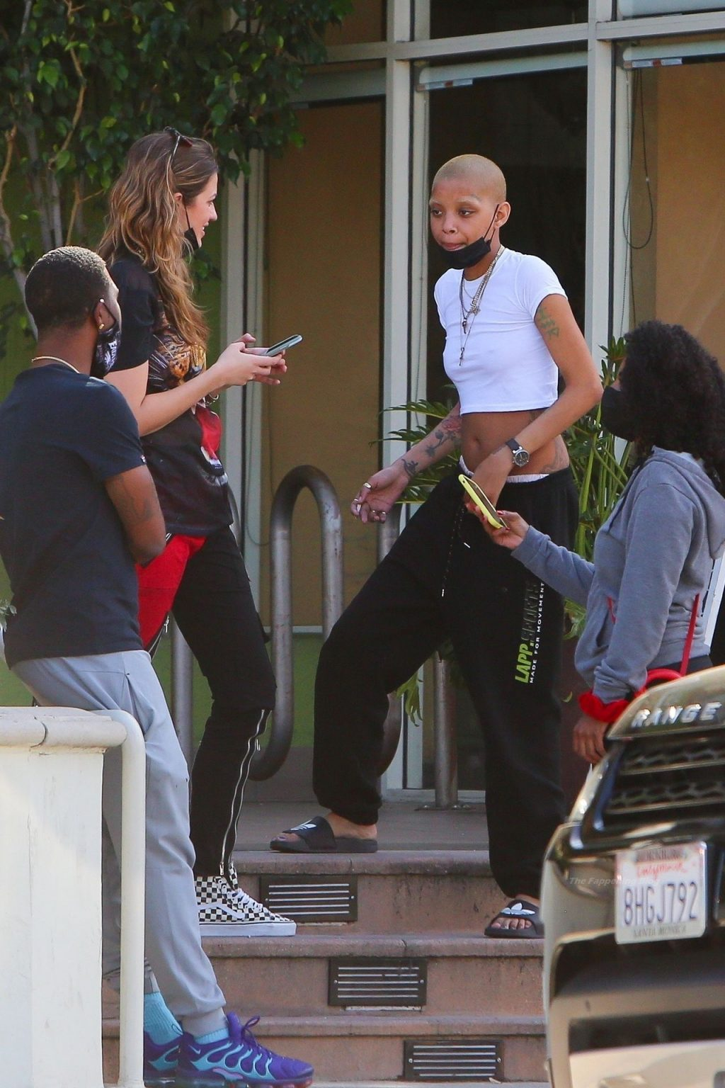 Braless Slick Woods is Pictured Socializing with Friends (22 Photos)