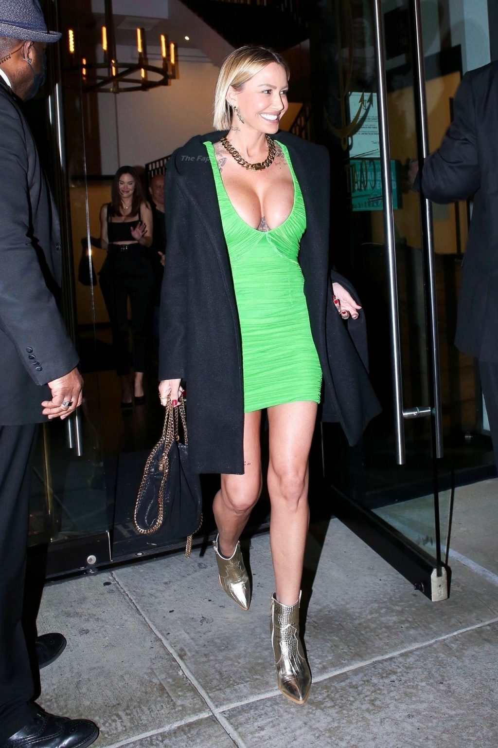 Tina Louise Puts on a Busty Display as She Grabs Dinner in WeHo (7 Photos)