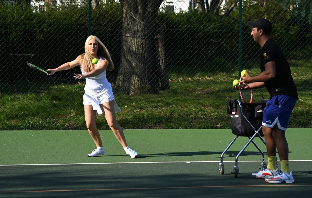 Caprice Makes the Most of the Sunshine and Gets Out on the Court for a Tennis Lesson (16 Photos)