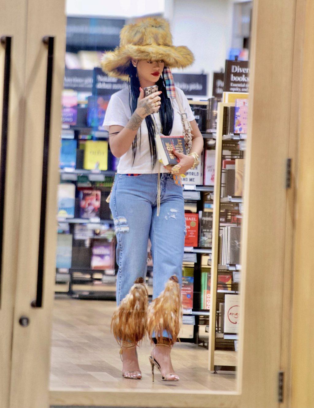 Rihanna Looks Flawless in a Fur Hat and Feathered Jeans (25 Photos)