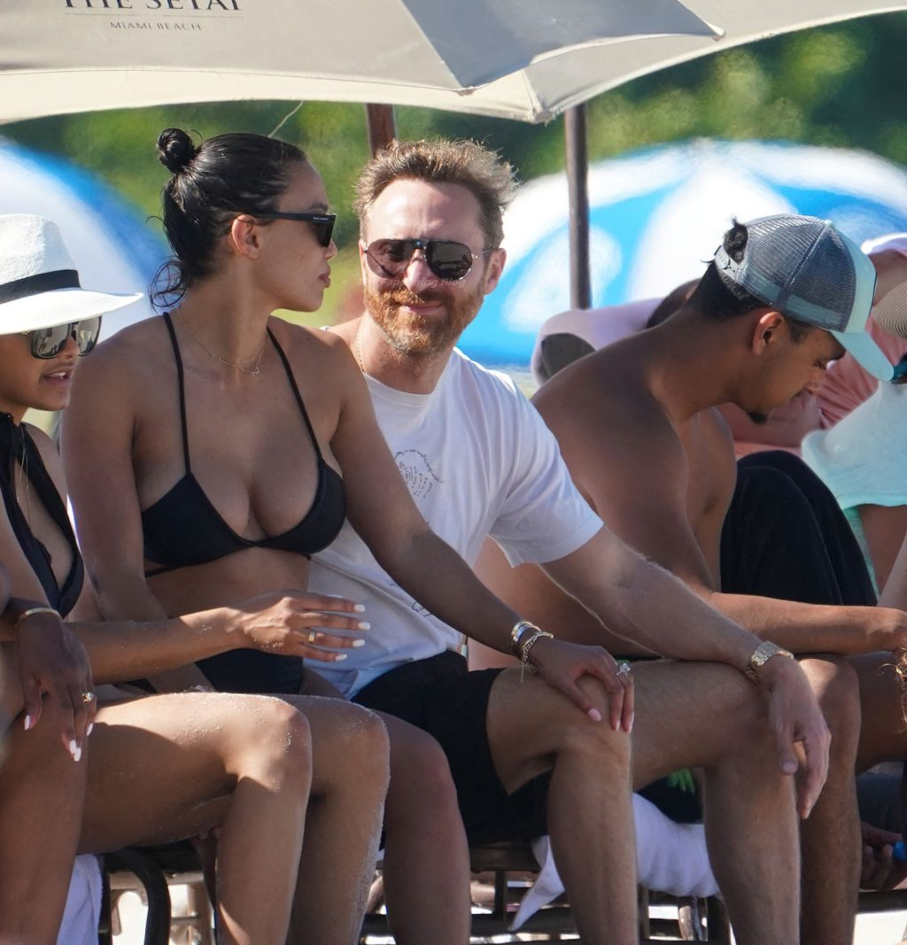 DJ David Guetta & Jessica Ledon are Seen at The Beach in Miami (19 Photos)