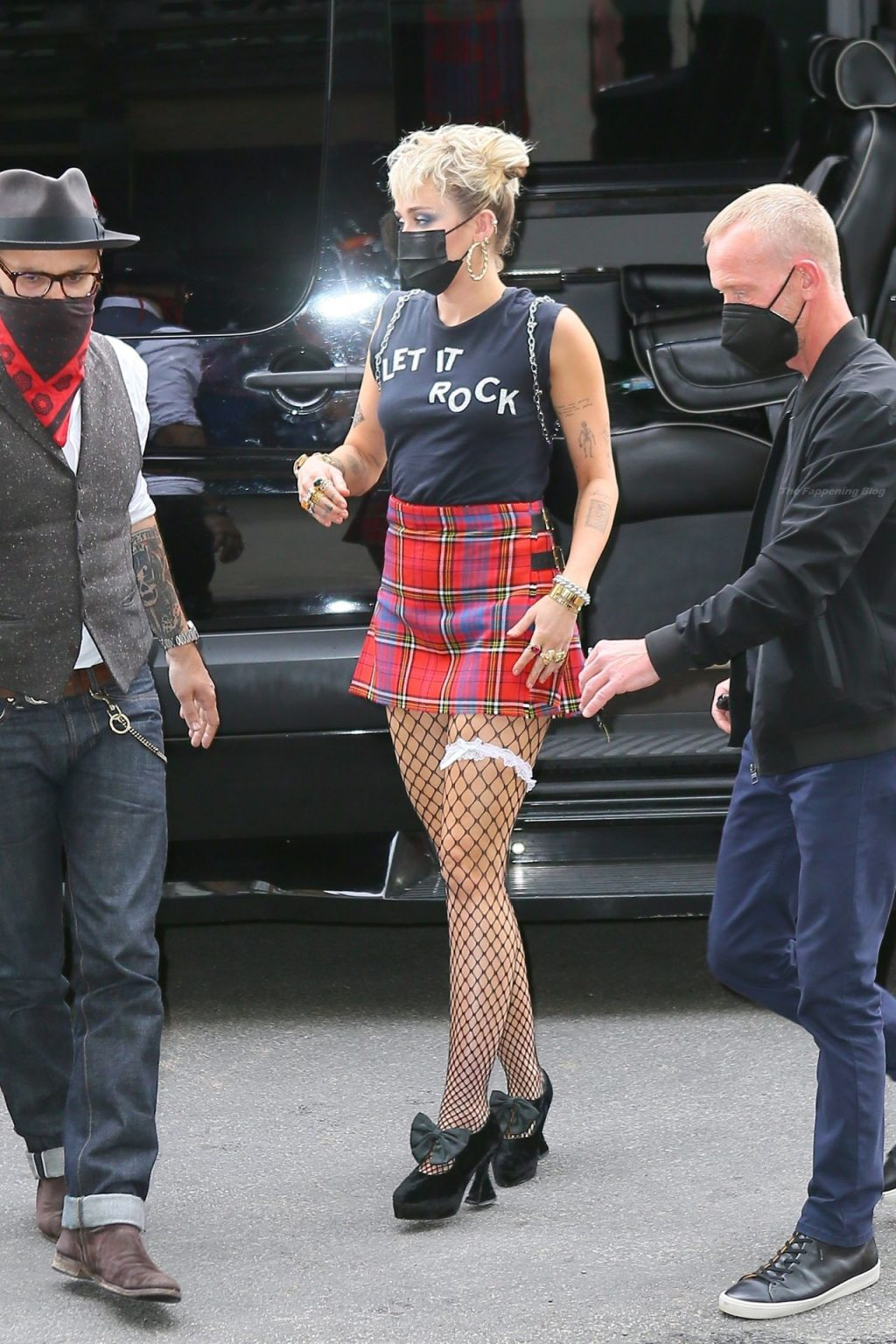 Miley Cyrus Grabs Attention in a Mini Skirt and Fishnets in NYC (22 Photos)