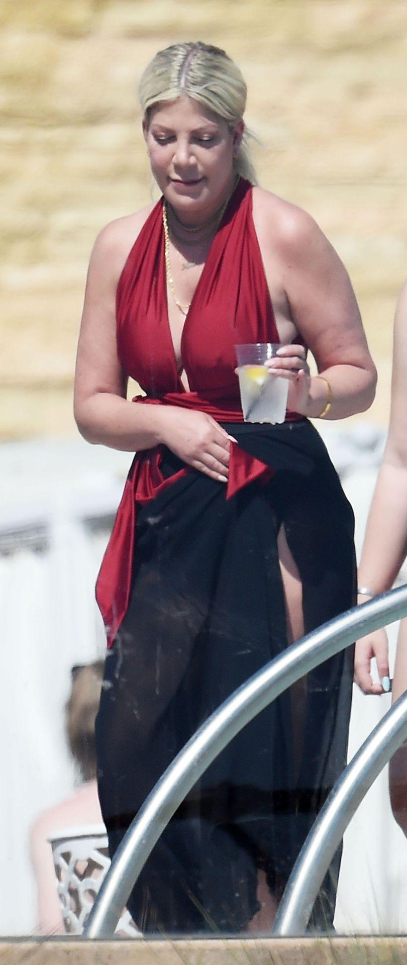 Tori Spelling Slips Into Her Swimsuit with Dean McDermott (46 Photos)