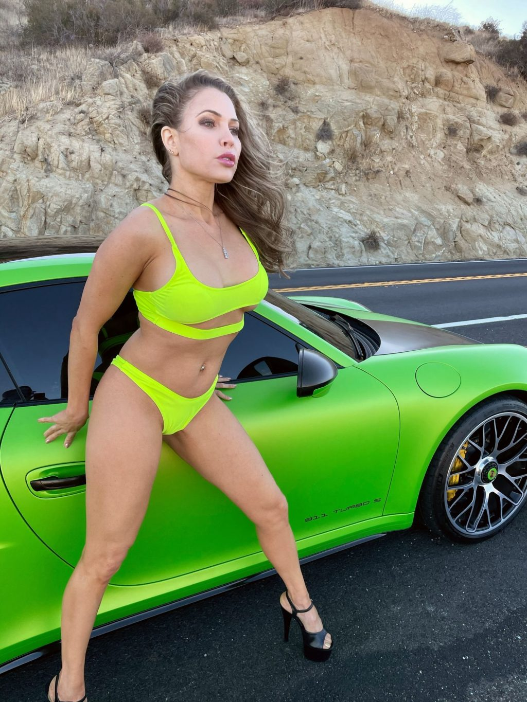 Erika Jordan Shows Off Her New Porsche and Her Matching Bikini (6 Photos)