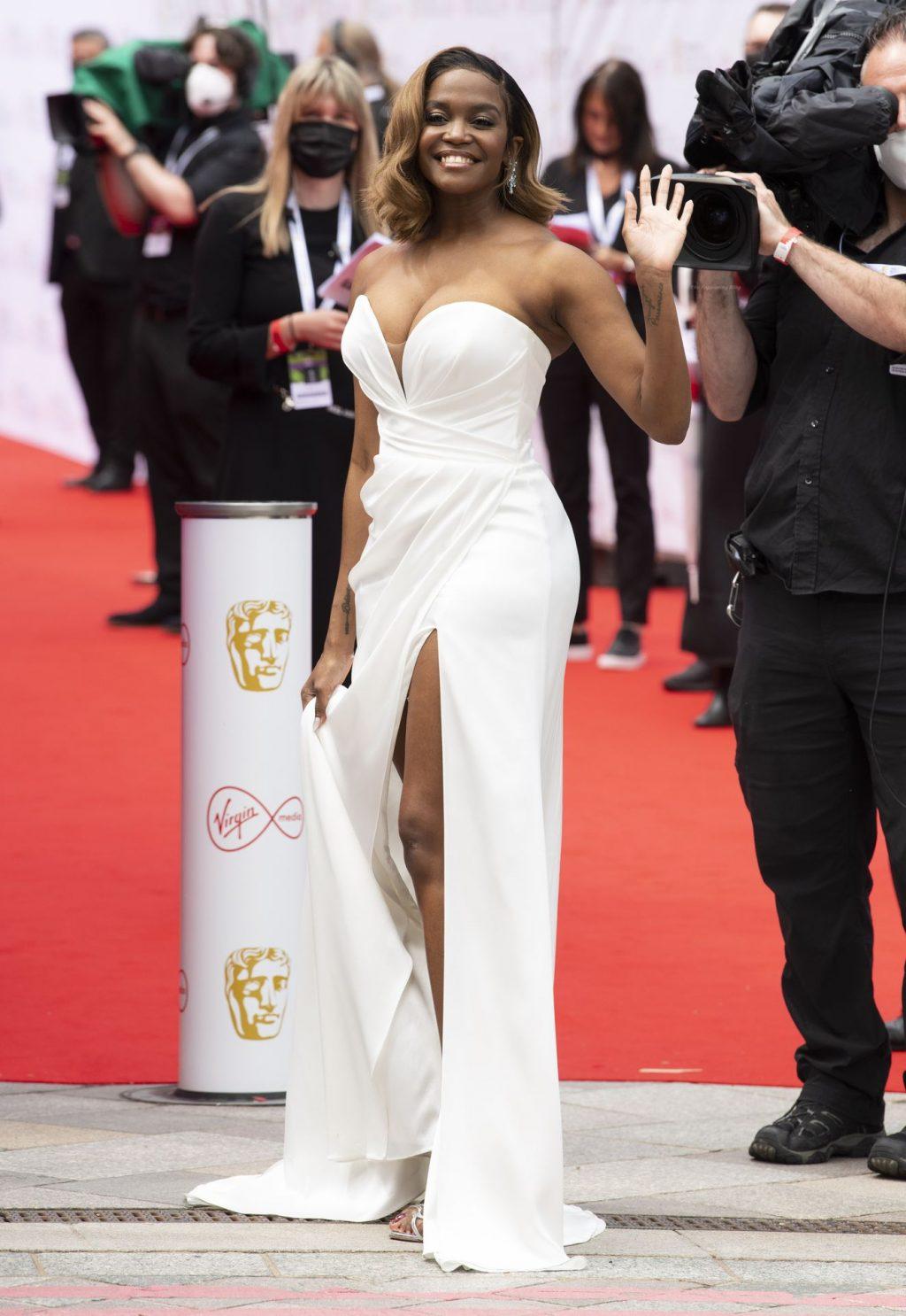 Busty Oti Mabuse Stuns in a White Dress at 2021 Virgin Media British Academy Awards (8 Photos)