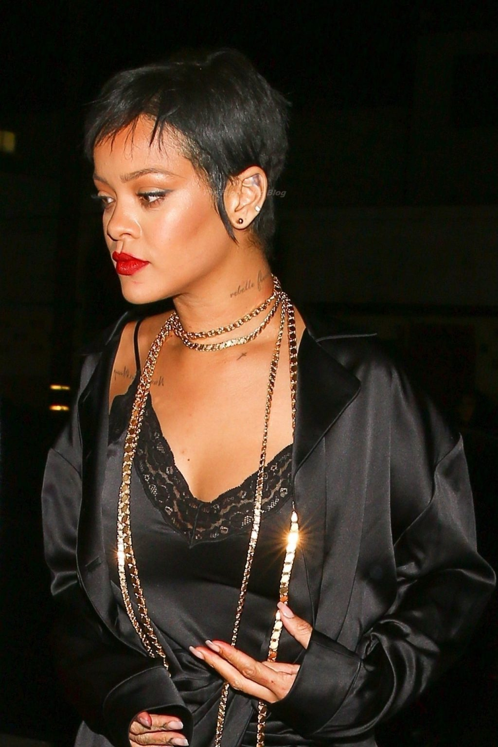 Rihanna Puts on a Sultry Display in Black Silk While Leaving Delilah Nightclub with Friends (22 Photos)
